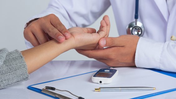 World diabetes day;docter checking  patient pulse's